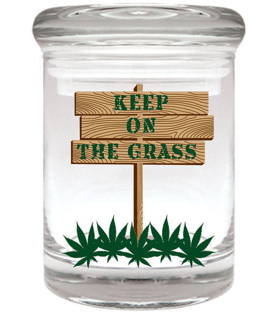 "Smell proof 1/4 ounce stash jar with ""keep on the grass"" sign graphic"