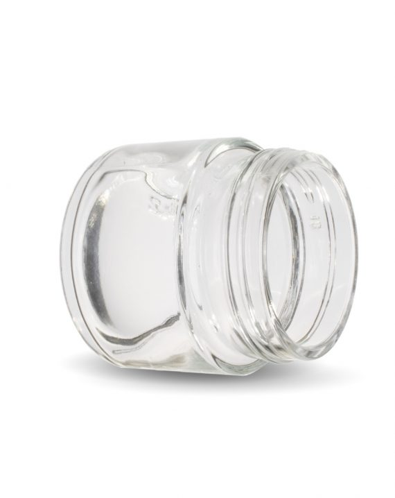 Photo of Cannaline's 2 Oz clear glass child resistant c-class jar laying on its side with the neck of the jar facing the camera