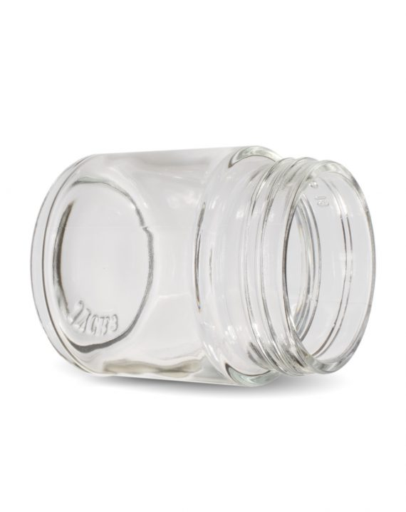Photo of Cannaline's 3 Oz clear glass child resistant c-class jar laying on its side with the neck of the jar facing the camera